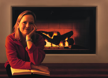 Women by propane gas fireplace