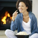 Women eating popcorn by propane gas fireplace