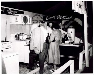 H.L. Revere at an early trade show, explaining the benefits of propane gas for cooking.