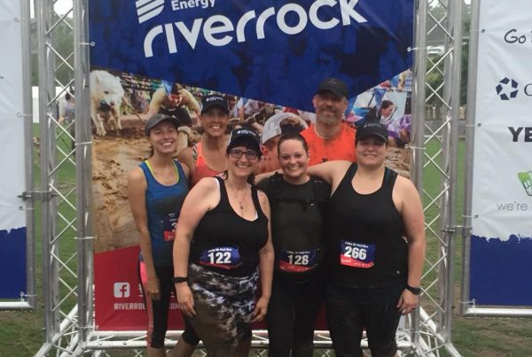 group photo after a 5k mud run
